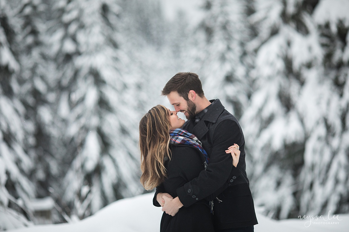 Neyssa Lee Photography, Seattle Family Photographer, Best time for family photos winter, family photos in the snow,  couple snuggled together in the snow