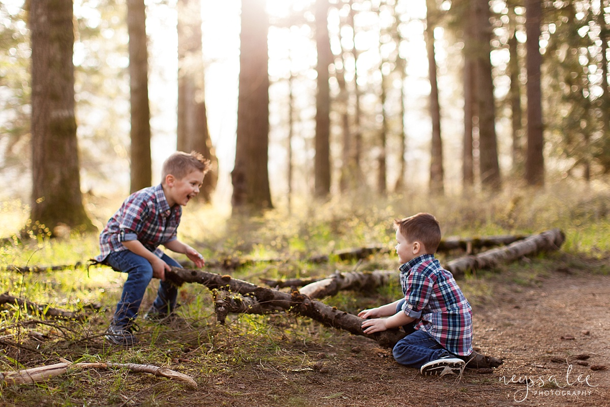 Neyssa Lee Photography, Seattle Family Photographer, Family Photos in Spring,  Brothers playing in the woods with beautiful light
