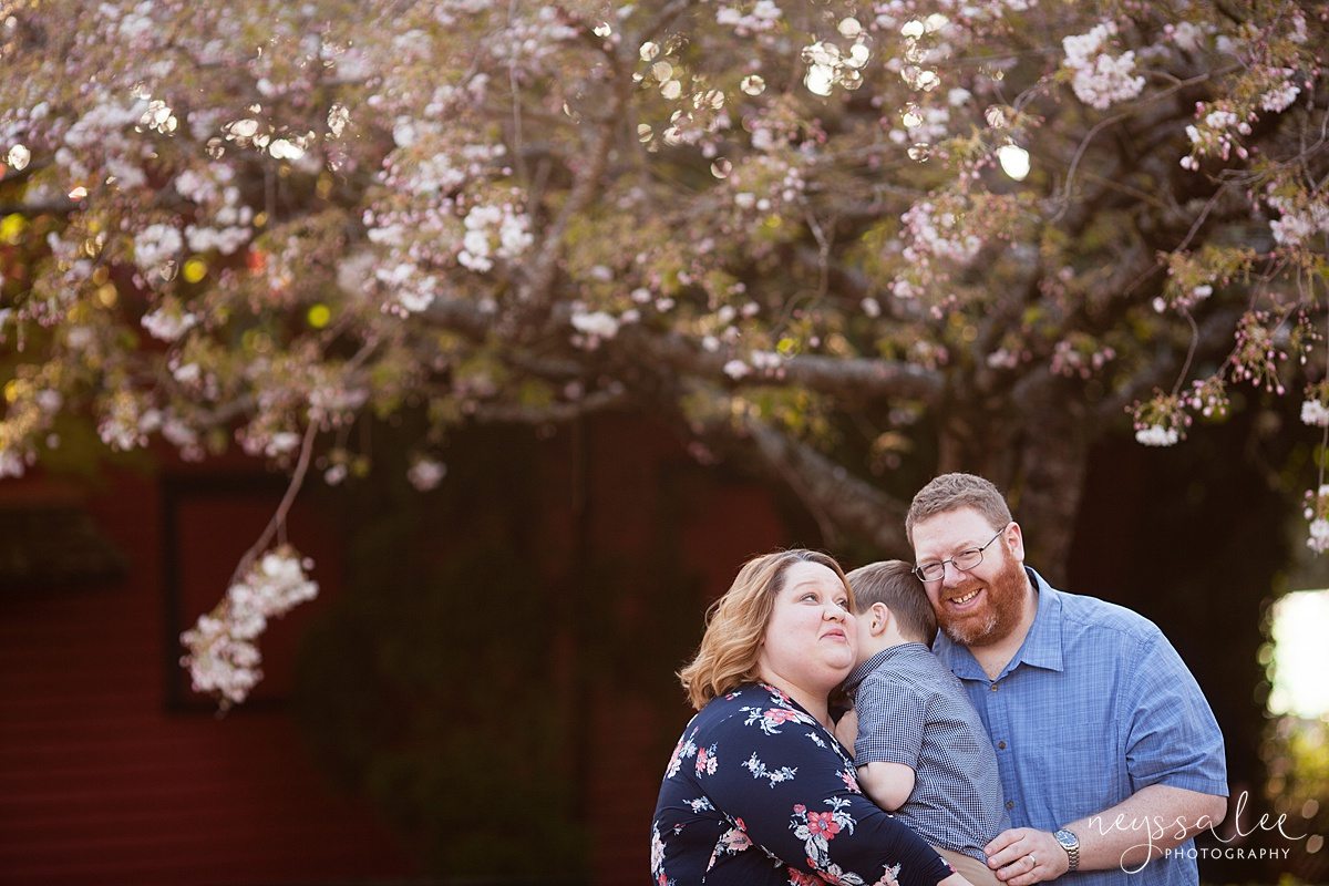Neyssa Lee Photography, Seattle Family Photographer, Family Photos in Spring, Family snuggled together with spring blossoms