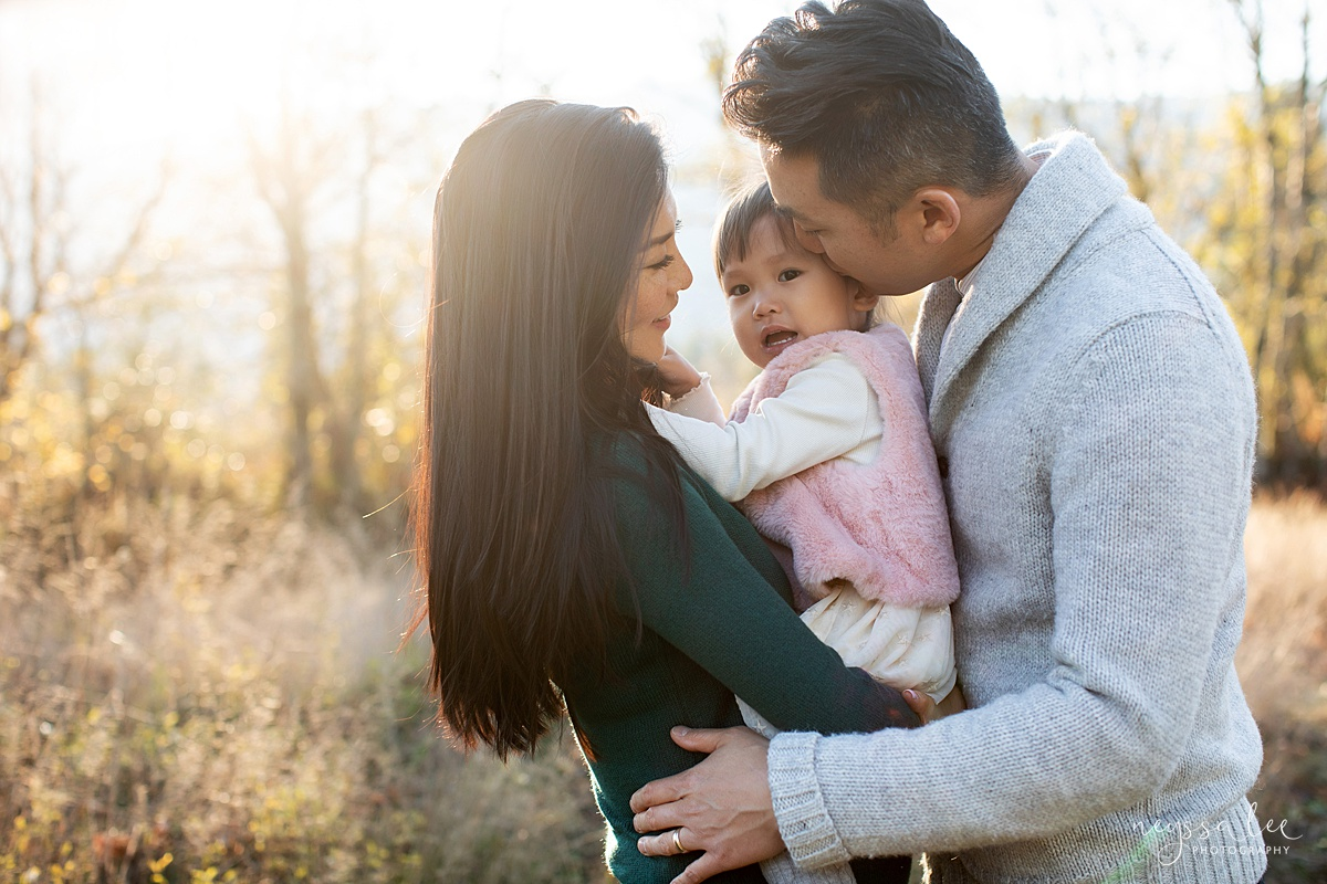 Neyssa Lee Photography, Seattle Lifestyle Family Photographer,  Photo of Mom and dad holding toddler girl in beautiful light