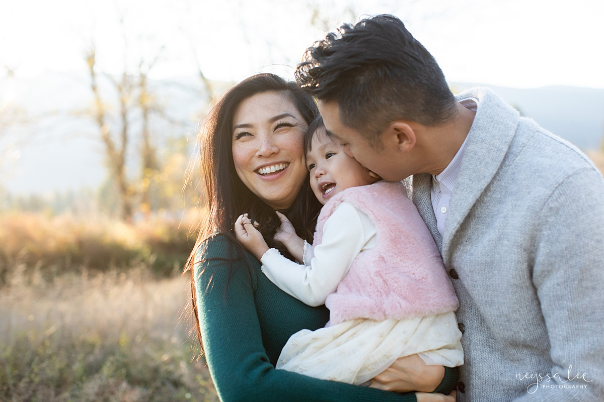 Neyssa Lee Photography, Seattle Lifestyle Family Photographer,  Photo of Mom holding toddler girl while dad kisses her cheek