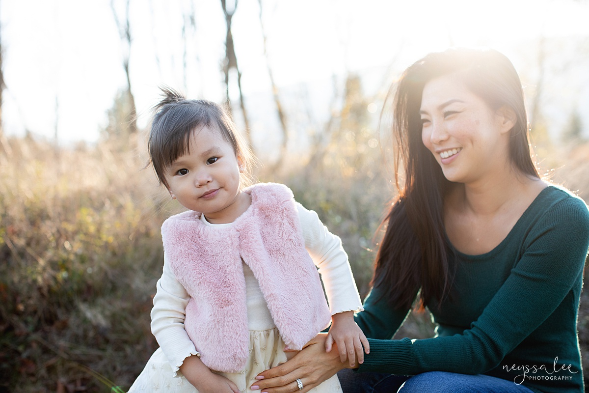 Neyssa Lee Photography, Seattle Lifestyle Family Photographer,  Photo of toddler girl laughing at camera with mom smiling in the background