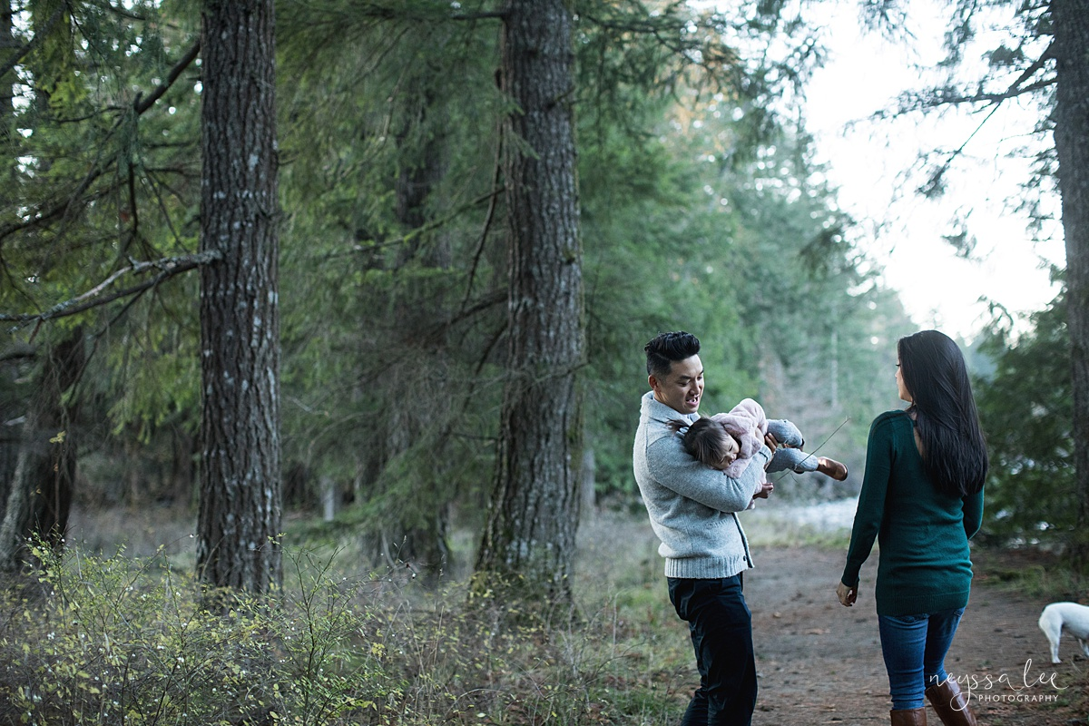 Neyssa Lee Photography, Seattle Lifestyle Family Photographer,  Playful photo of family of three on a wooded trail