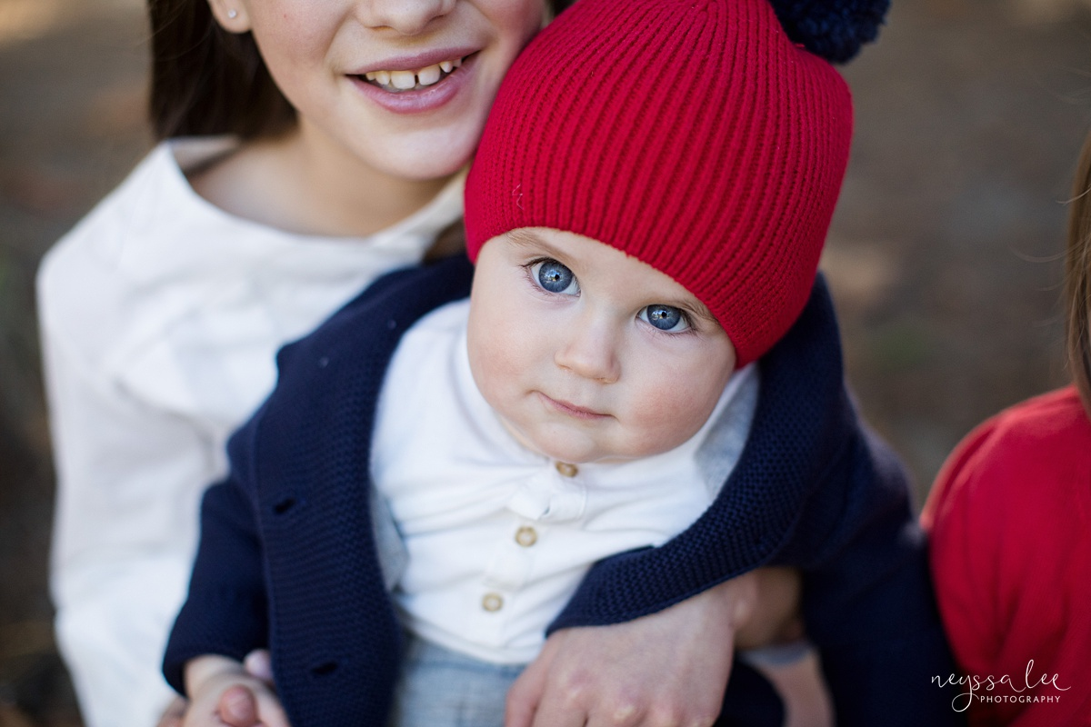 Seattle family photographer, Neyssa Lee Photography, How to dress your kids for family photos, photo tips, photo of baby boy in red hat, Snoqualmie lifestyle family photographer