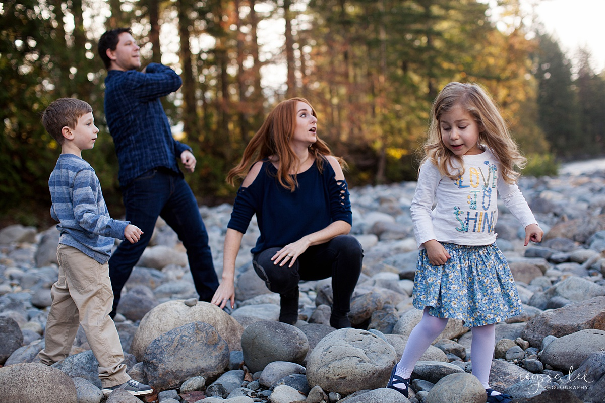 Neyssa Lee Photography, Photo of family throwing rocks at the river, lifestyle family photography, Seattle Family Photographer