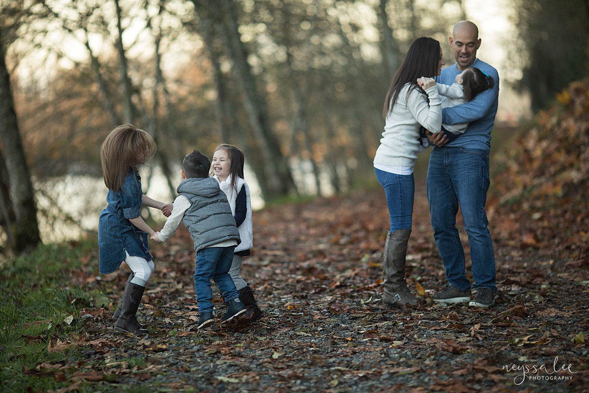 Neyssa Lee Photography, Snoqualmie Family Photographer, Large family photo, Lifestyle photo of siblings playing together with parents in background