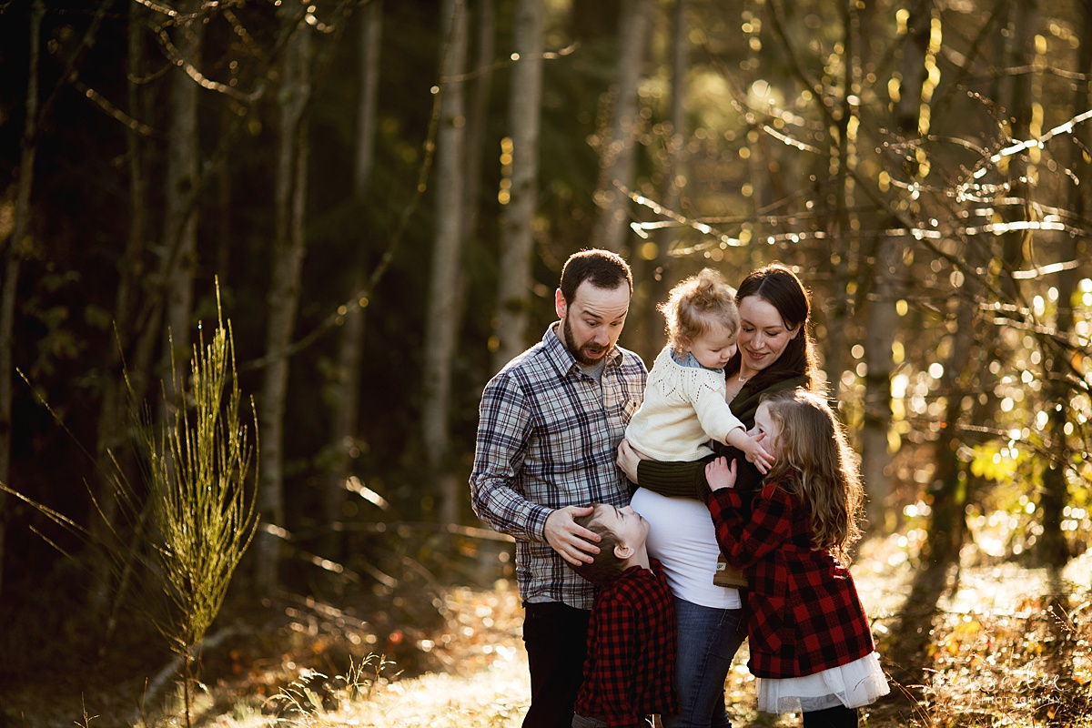 Tips to Rock Your Maternity Session, Neyssa Lee Photography, Seattle Maternity Photographer, Issaquah Newborn Photographer, Maternity photo of family of five cuddled together in beautiful back light
