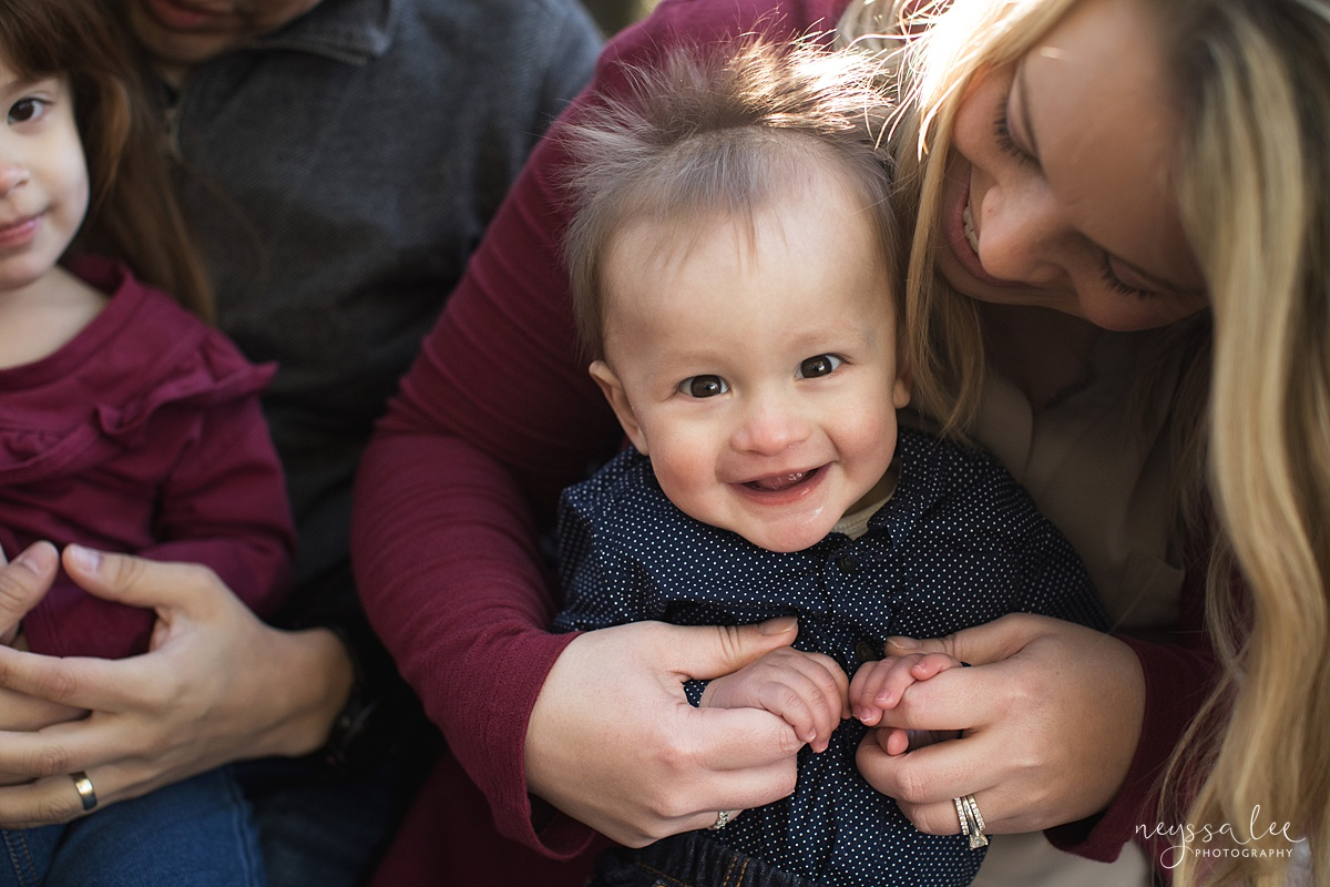 Uncooperative Kids During Family Photos, Neyssa Lee Photography, Seattle Family Photographer, Issaquah Photography, Photo of baby boy smiling in moms arms