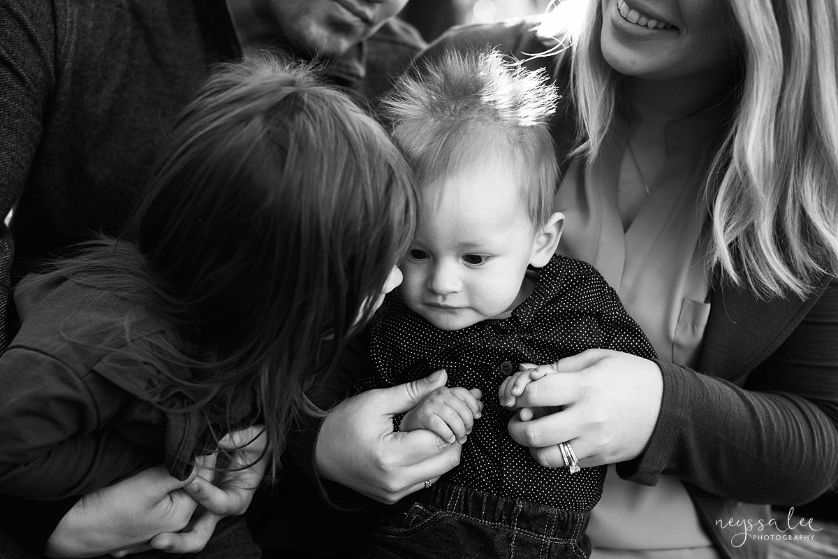 Uncooperative Kids During Family Photos, Neyssa Lee Photography, Seattle Family Photographer, Issaquah Photography, Black and white photo of big sister kissing baby brother
