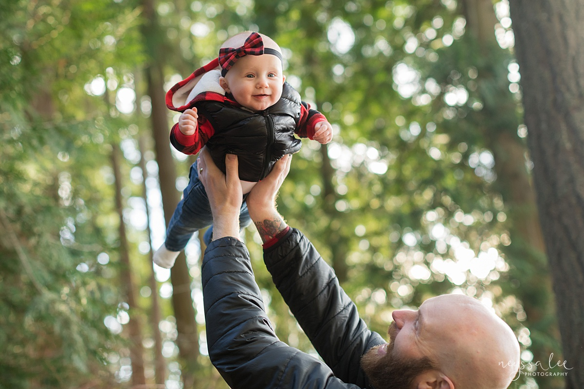 Best Age to Photograph Baby, Neyssa Lee Photography, Seattle Baby Photographer, Photo of dad lifting baby girl into the air