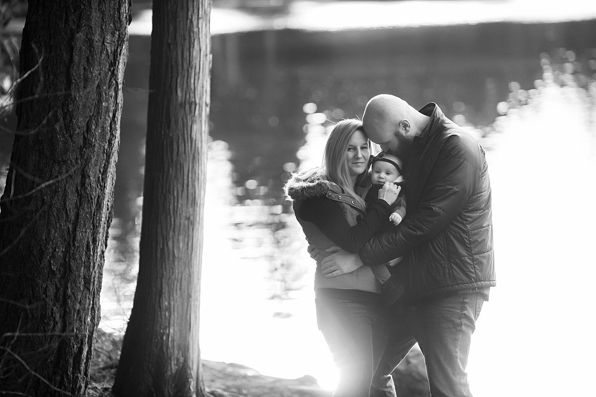 Best Age to Photograph Baby, Neyssa Lee Photography, Seattle Baby Photographer, Black and white photo of family by the lake