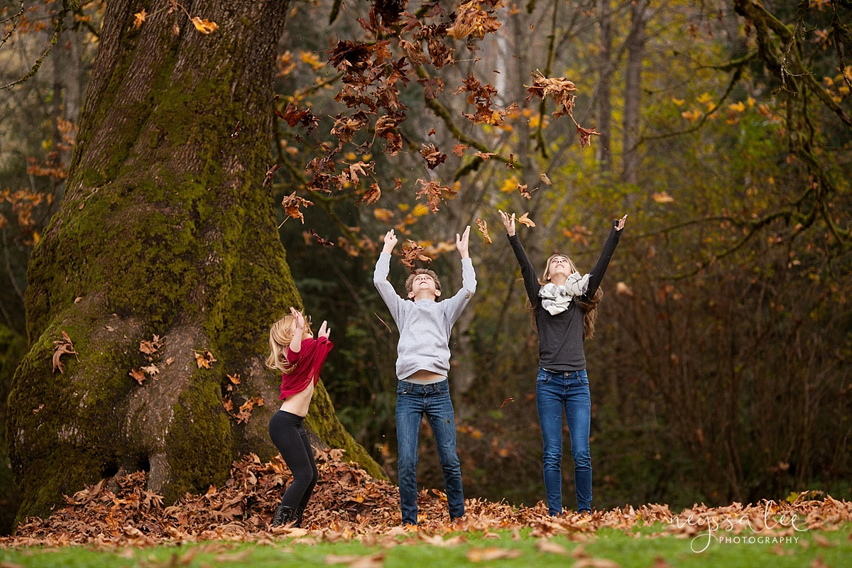Family Photos in Fall, Neyssa Lee Photography, Seattle Family Photographer, Photo of children tossing  fall leaves into the air