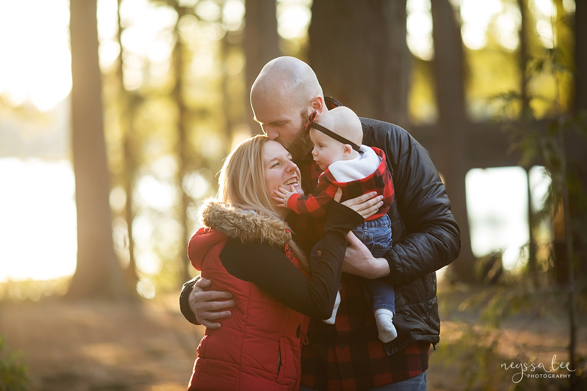 Neyssa Lee Photography, What to Wear For Family Photos, Red for Family Photos, Seattle Family Photographer, Photo of family wearing red and black loving on baby girl
