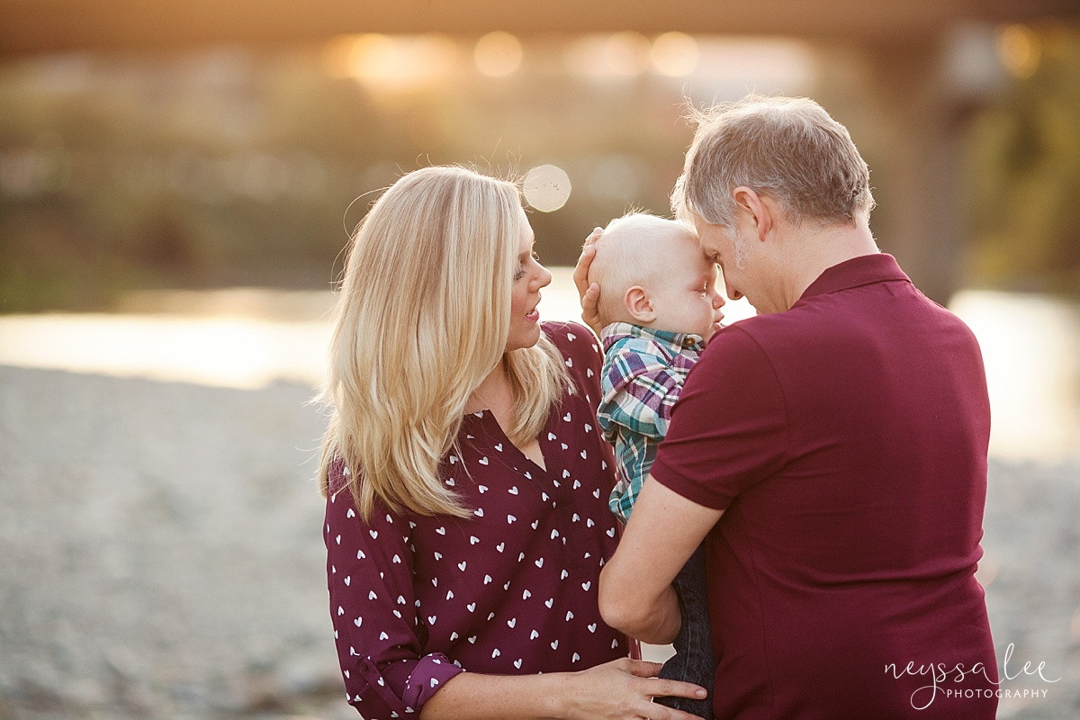 Neyssa Lee Photography, What to Wear For Family Photos, Red for Family Photos, Seattle Family Photographer,  Photo of mom and dad comforting baby boy, Photo of family wearing teal and maroon