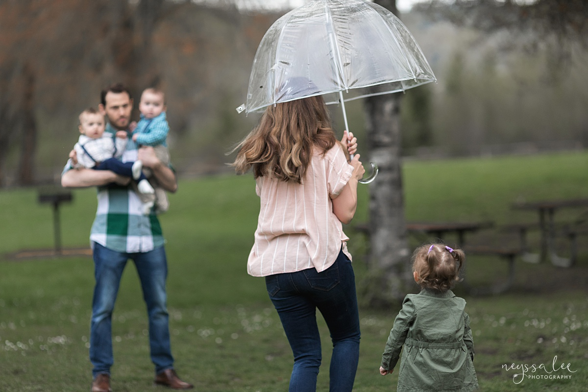 Neyssa Lee Photography, Issaquah Family Photographer, Family Photos with Grey Skies, Lake Sammamish State Park, Photo of mom running with umbrella