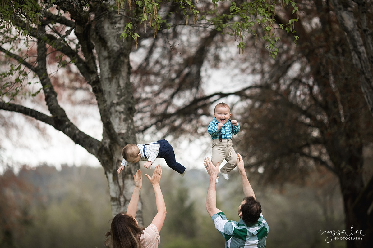 Neyssa Lee Photography, Issaquah Family Photographer, Family Photos with Grey Skies, Lake Sammamish State Park, Photo of parents playfully tossing twin boys into air