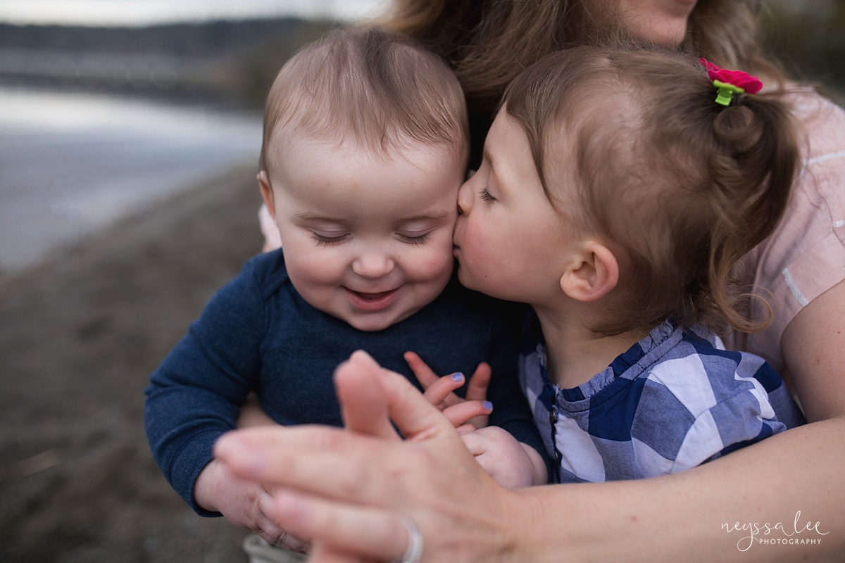 Neyssa Lee Photography, Issaquah Family Photographer, Family Photos with Grey Skies, Lake Sammamish State Park, Photo of big sister kissing baby brother