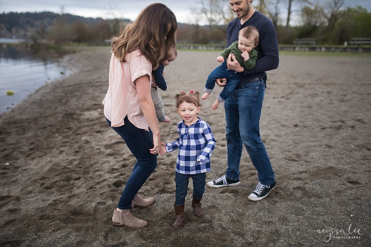 Neyssa Lee Photography, Issaquah Family Photographer, Family Photos with Grey Skies, Lake Sammamish State Park, Photo of family dancing together on the beach
