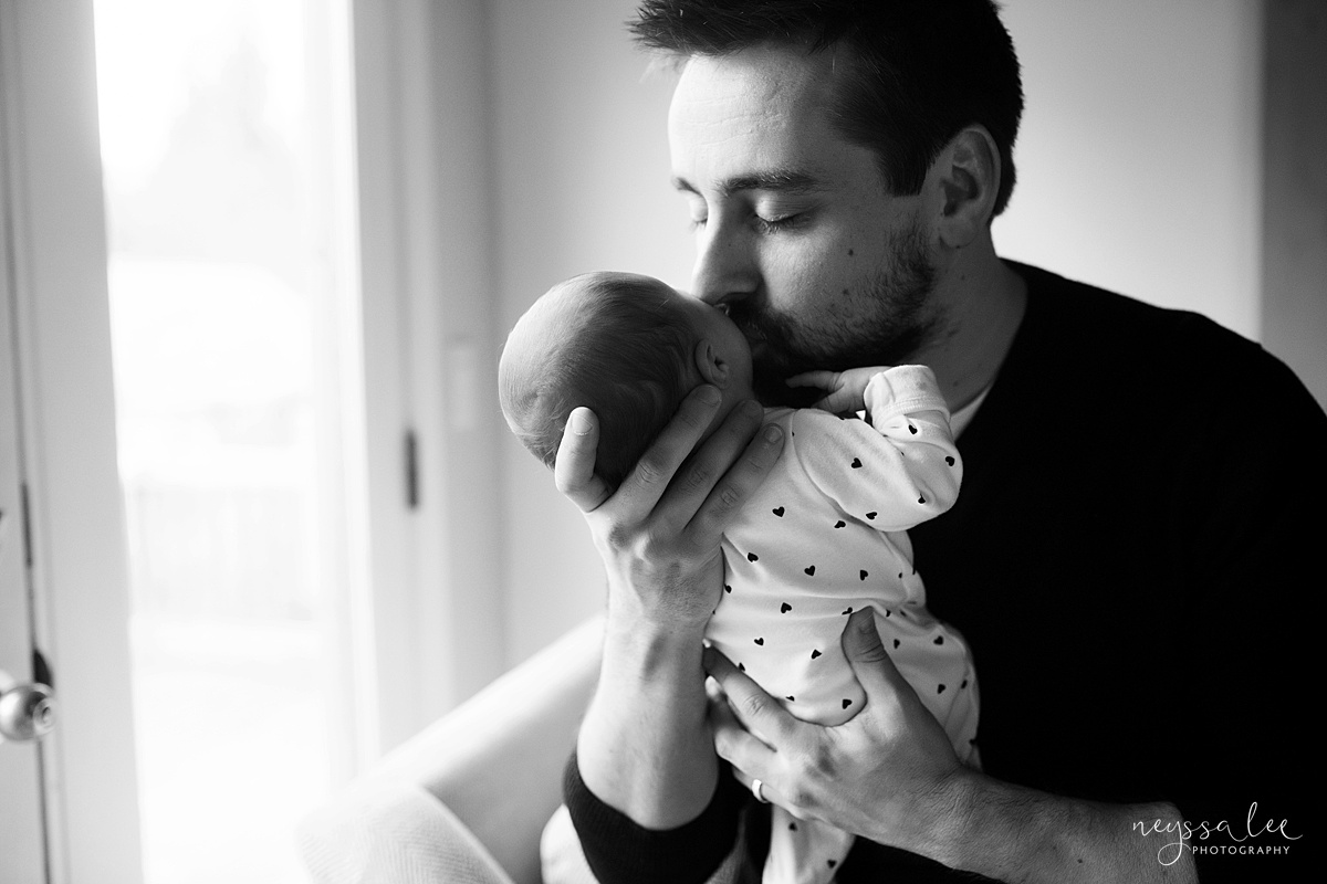Neyssa Lee Photography, Seattle Newborn Photographer,  Newborn Photo Session Experience, Black and white photo of dad kissing newborn baby