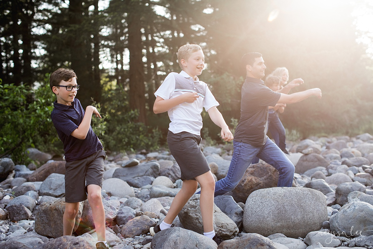 Neyssa Lee Photography, Family Photos with Older Kids, Bellevue Family Photographer, Snoqualmie Family Photography, Family of 5,  Photo of family skipping rocks in beautiful light