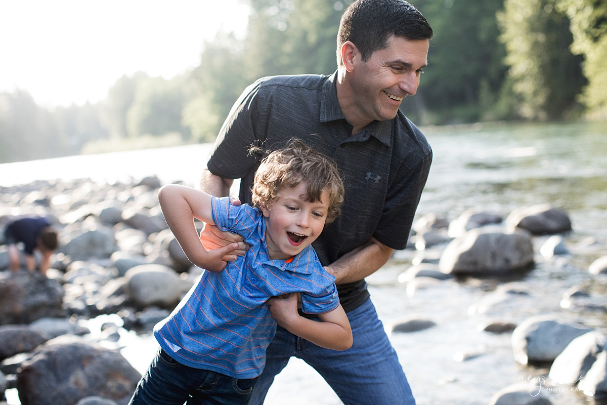 Neyssa Lee Photography, Family Photos with Older Kids, Bellevue Family Photographer, Snoqualmie Family Photography, Family of 5,  playful photo of dad and son by the river
