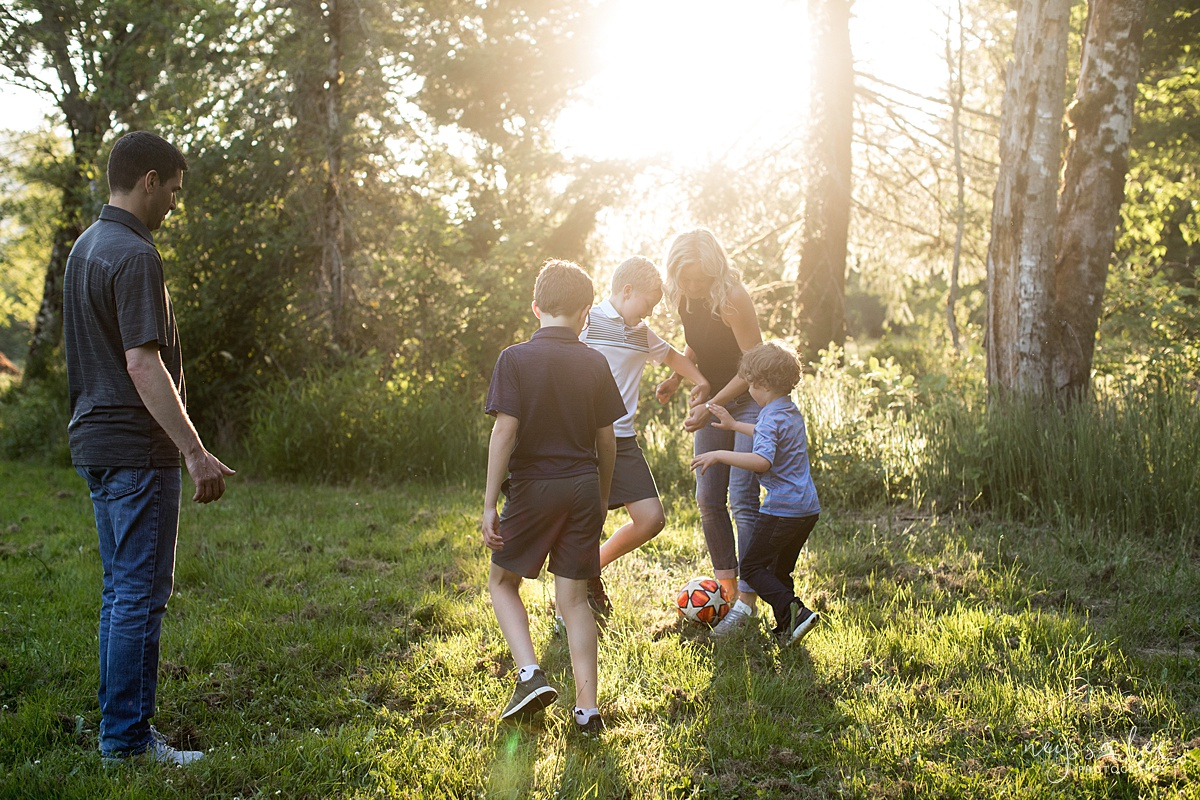 Neyssa Lee Photography, Family Photos with Older Kids, Bellevue Family Photographer, Snoqualmie Family Photography, Family of 5,  Photo of family playing soccer in beautiful light