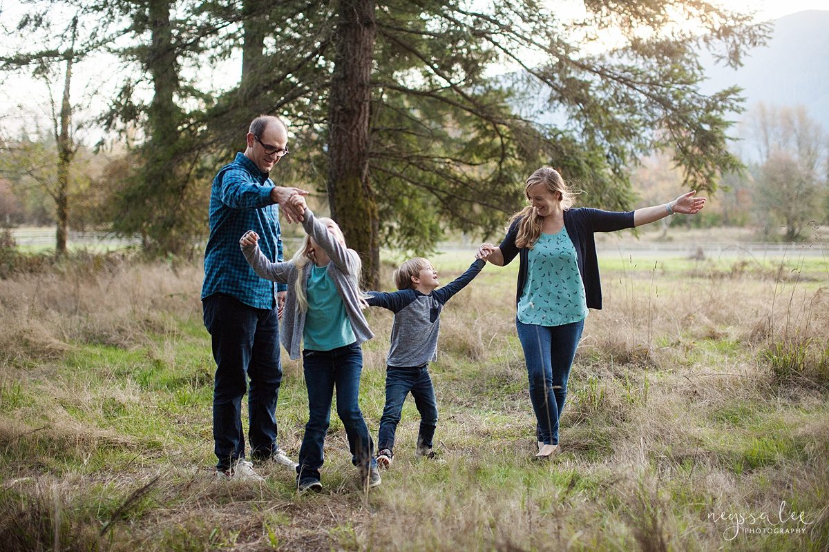 Neyssa Lee Photography, Seattle Family Photo Experience, Photo of family dancing together in a field