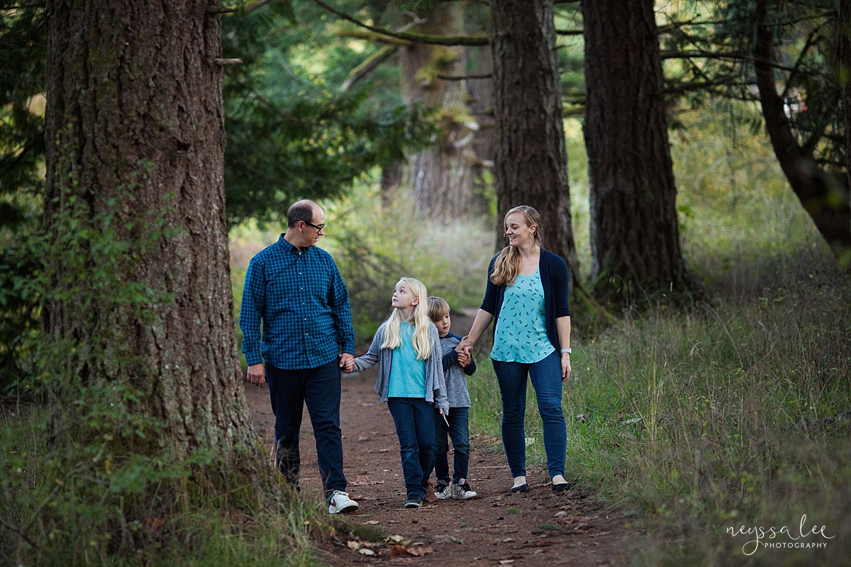 Neyssa Lee Photography, Seattle Family Photo Experience, Photo of family walking together on a wooded trail