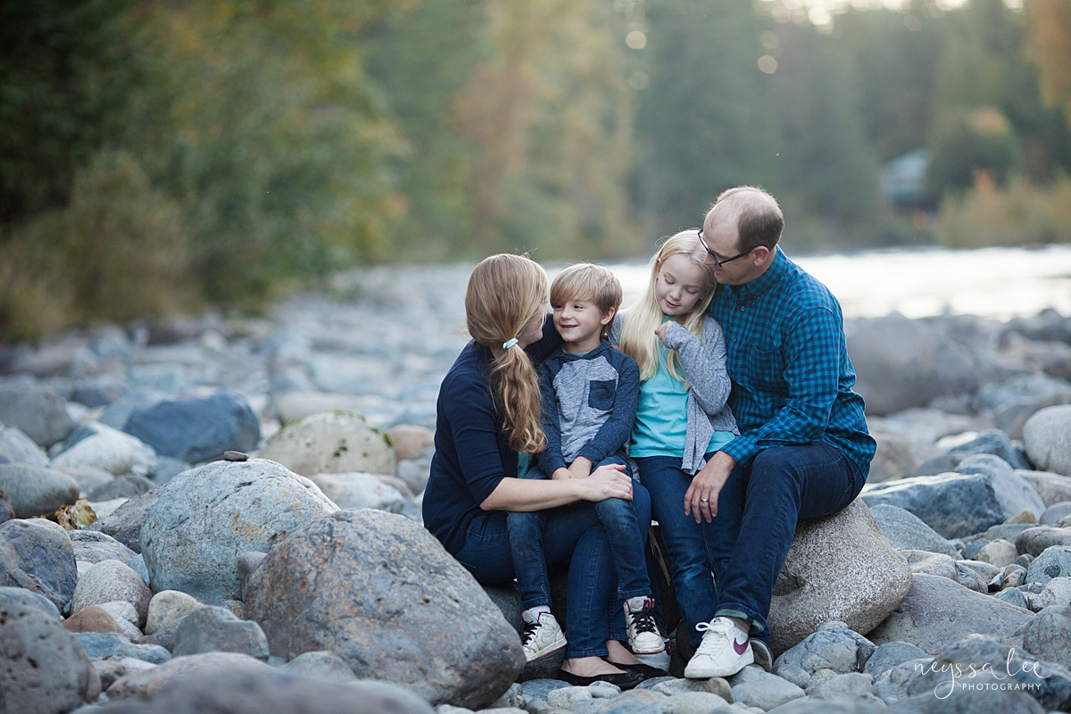 Neyssa Lee Photography, Seattle Family Photo Experience, Lifestyle family photo of family sitting on rocks by the river