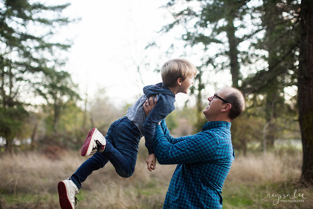 Neyssa Lee Photography, Seattle Family Photo Experience, Photo of dad lifting boy into the air
