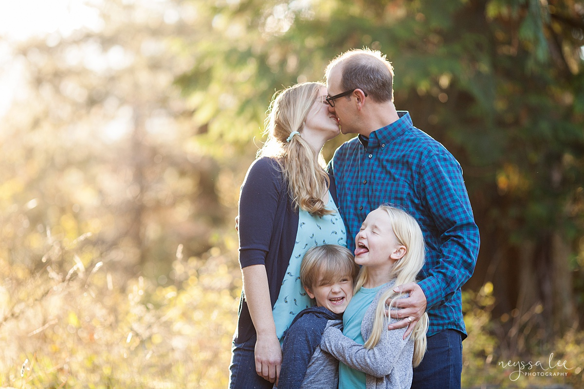Neyssa Lee Photography, Seattle Family Photo Experience, Photo of mom and dad kissing and girl making face