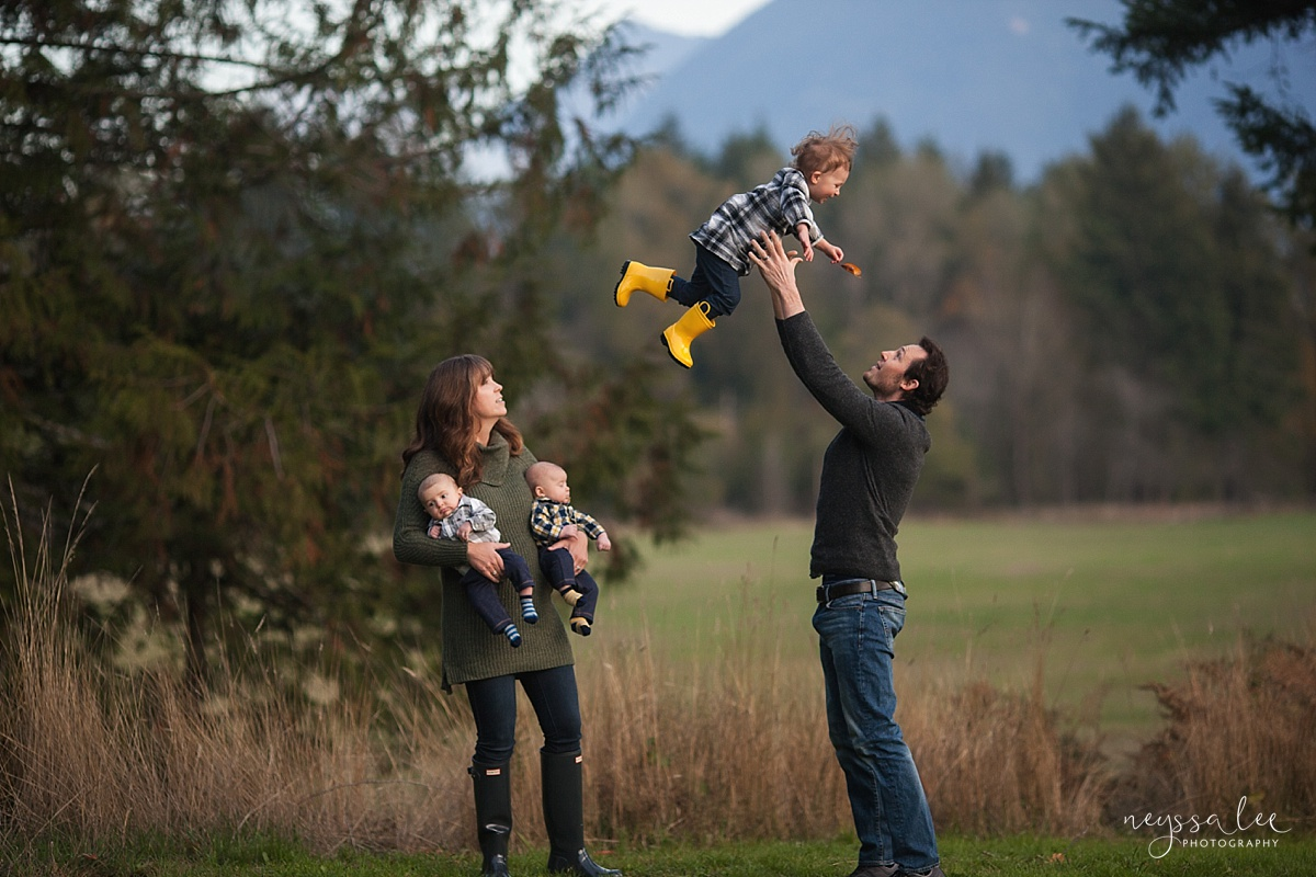 How to use fall accessories to make your family photos pop, Neyssa Lee Photography, Seattle family photographer, Playful family photo with girl in yellow rain boots