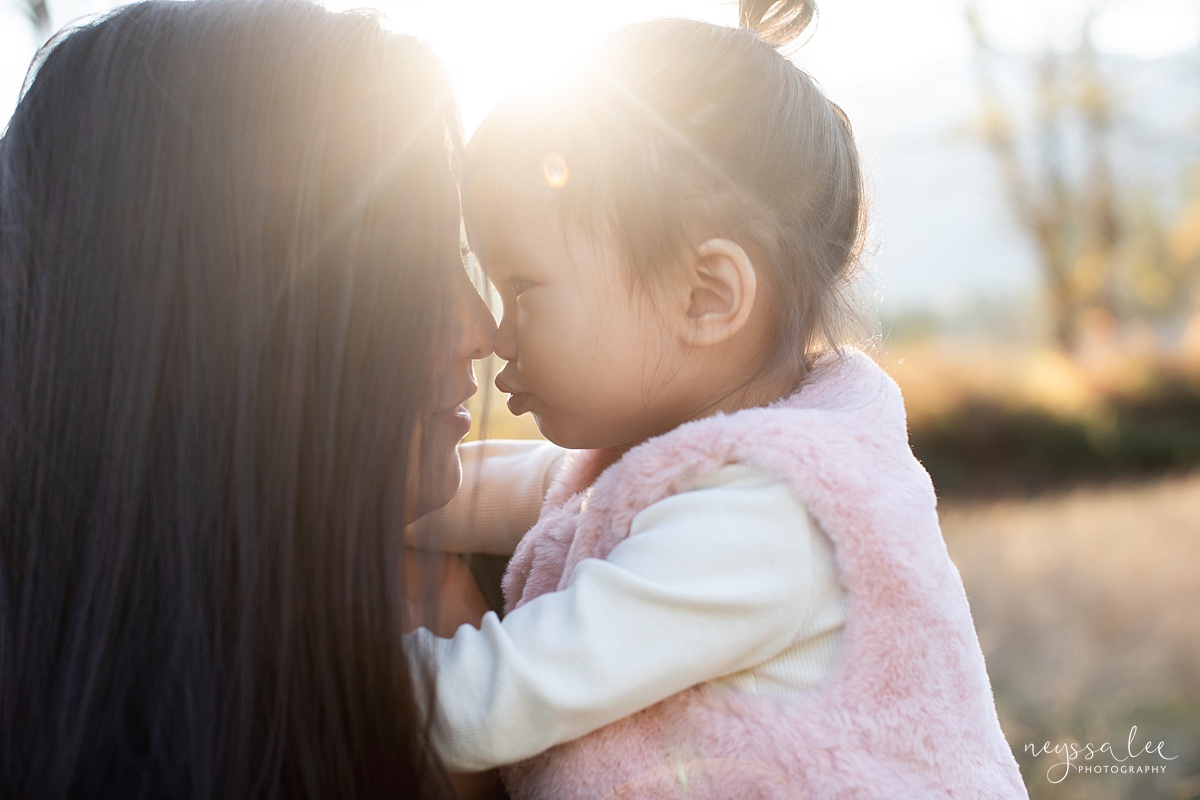 How to use fall accessories to make your family photos pop, Neyssa Lee Photography, Seattle family photographer, Photo of mother and daughter in beautiful light