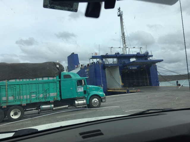 A truck going on the ferry. They pull forward and back in the bottom lot.