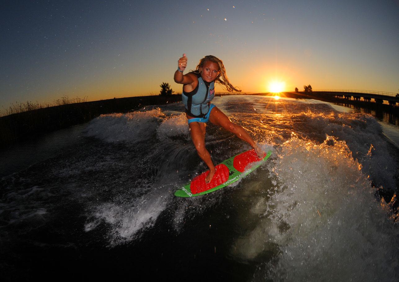 Wakesurfing Discovery Bay at sunset behind my Centurion Enzo wakesurf boat. Summer of 2012.