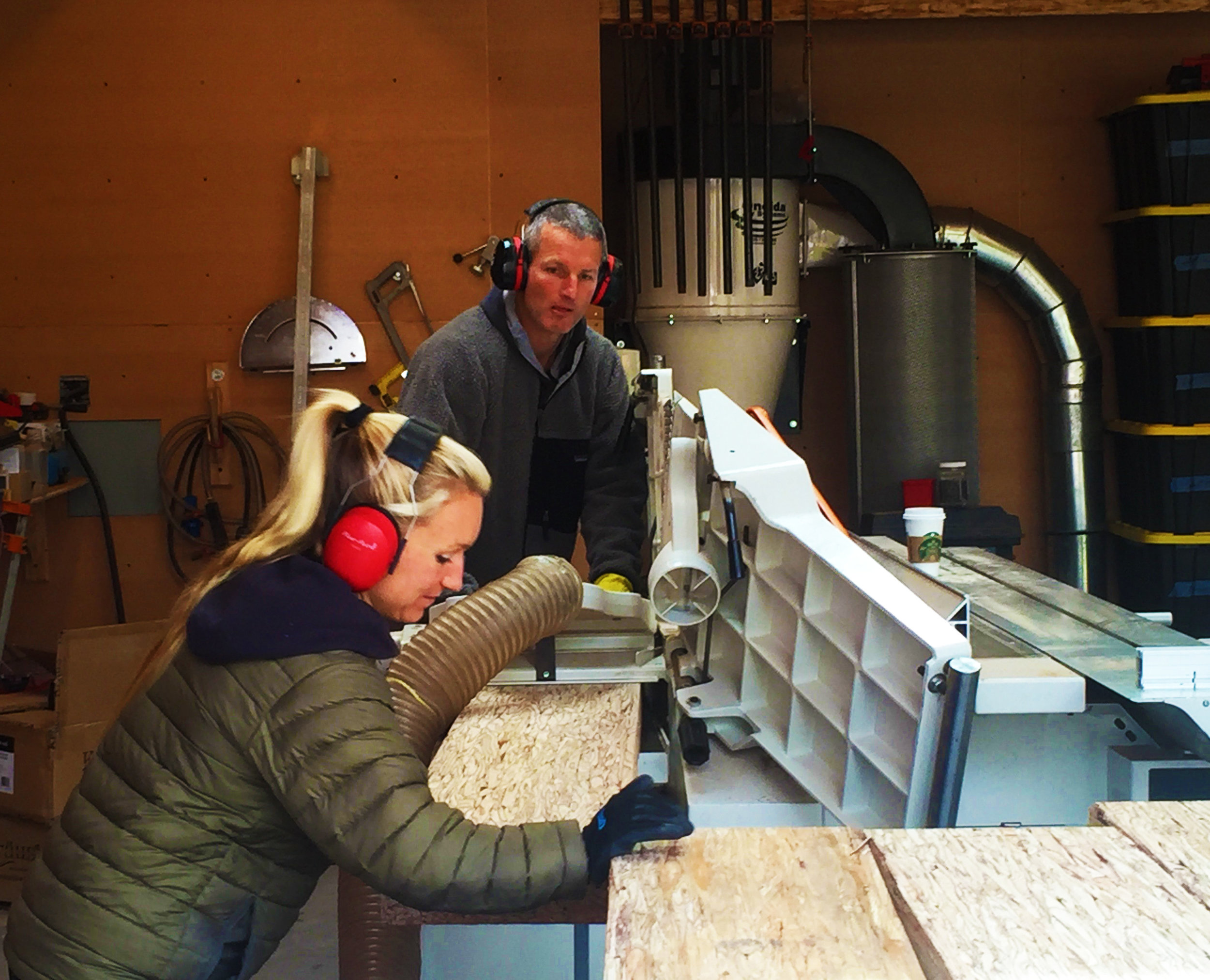 Hard at work planing the entry stairs in our woodshop on our combination woodworking machine.