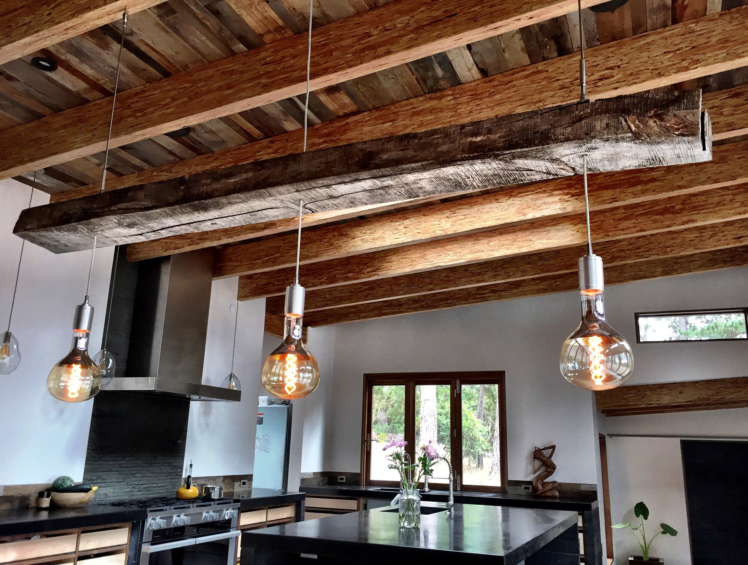 The ceilings of the Carmel HIghlands house are all barn wood and PSL beams. I made the dining room table light. Old growth chainsaw milled 60 year old tanbark oak beam I got off our friend's property in Big Sur, custom mogul sockets by @industriallightworks, huge mogul Edison bulbs, and stainless steel cables and turn buckles.