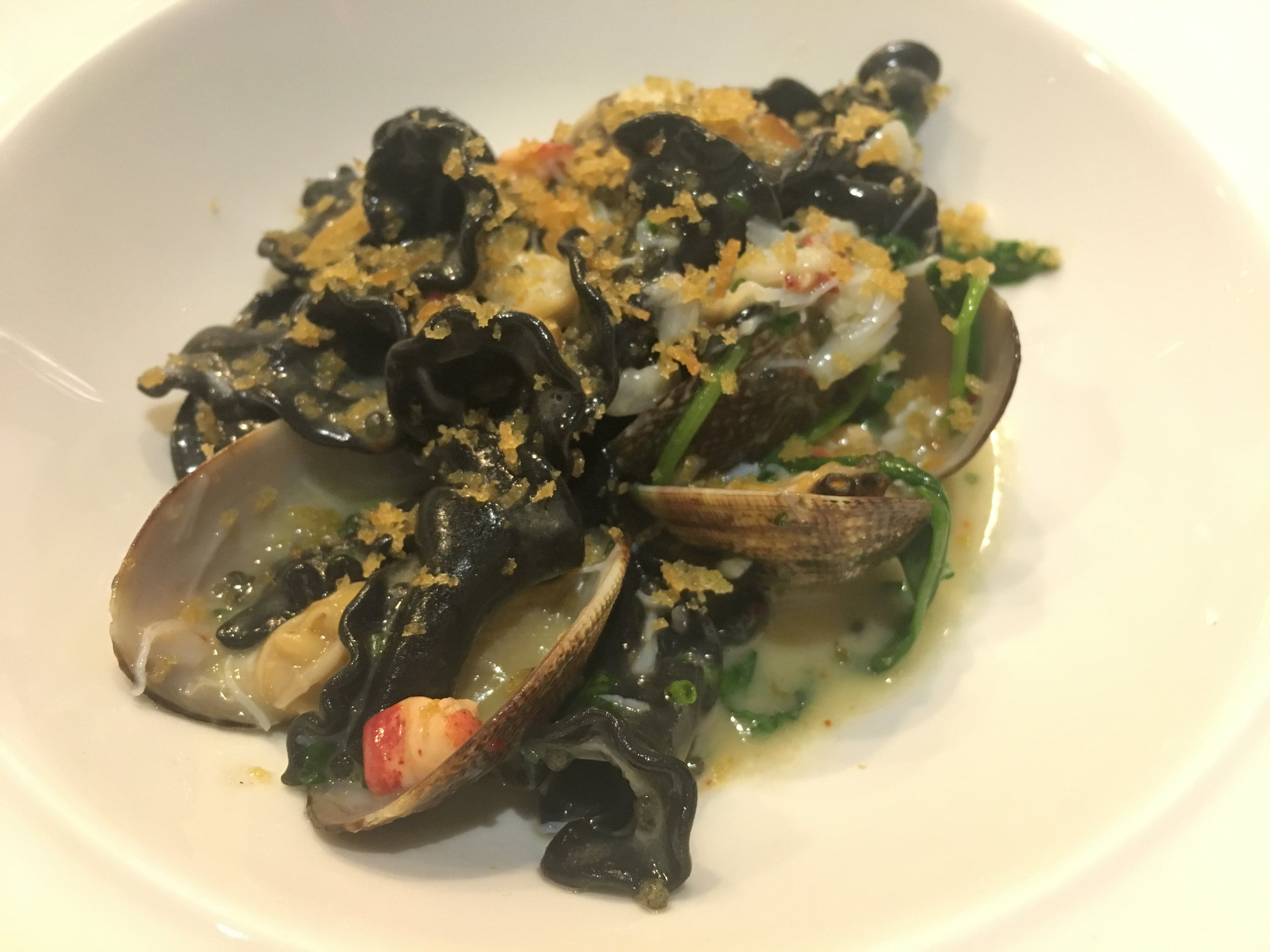 Squid ink carmenelli replete with peekytoe crab, lobster, caviar, and razor and manila clams