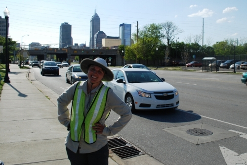 Tara, in yet another natural looking pose, with downtown Indy looming in the distance.