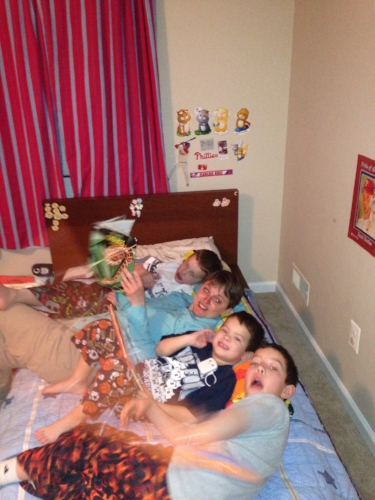 Tara reading a bed-time story (actually a bed-time snake encyclopedia) to the boys.