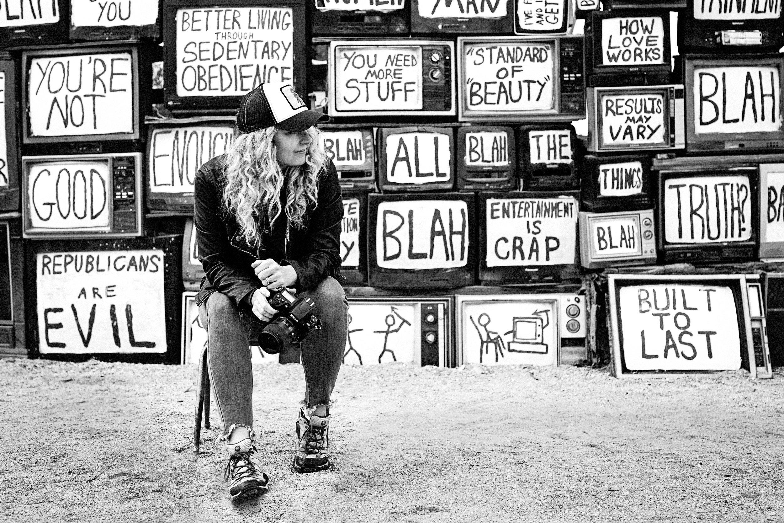 Jolene in front of an art installation in East Jesus (Niland, CA).