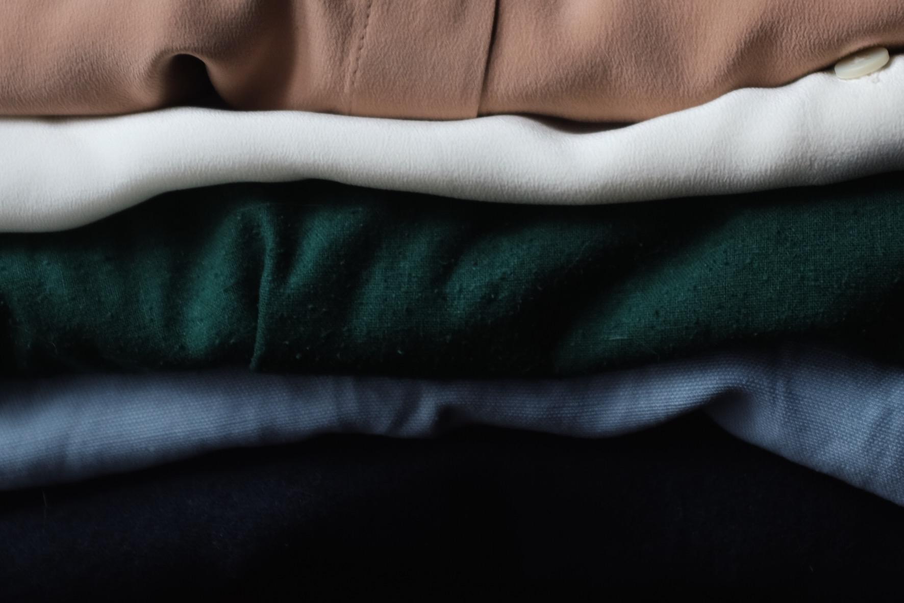 (Top to bottom) Everlane Modern Silk Blouse in Blush, Everlane the  Silk Round Collar in White , Jamie + the Jones  T Top in Emerald , Reformation Carmen dress in Skye, Elizabeth Suzann Andy Trouser in Navy.