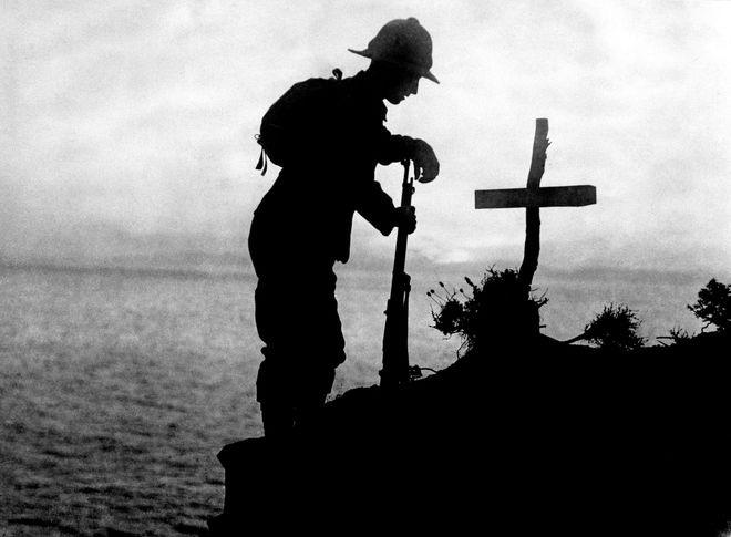 19-soldier-at-graveside.jpg