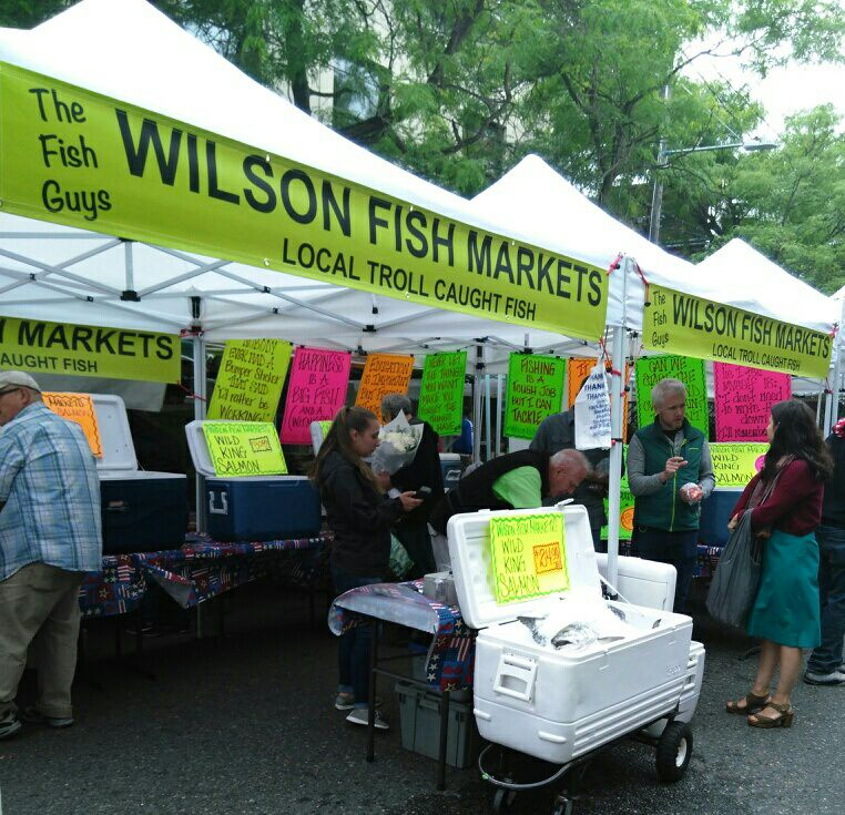 Wilson Fish Markets   Wilson Fish Markets is a local farmers market retailer operating at several local farmers markets in and around the Seattle/Tacoma area throughout the year. Tap the photo to be redirected to their Facebook page to see where they will be at next!