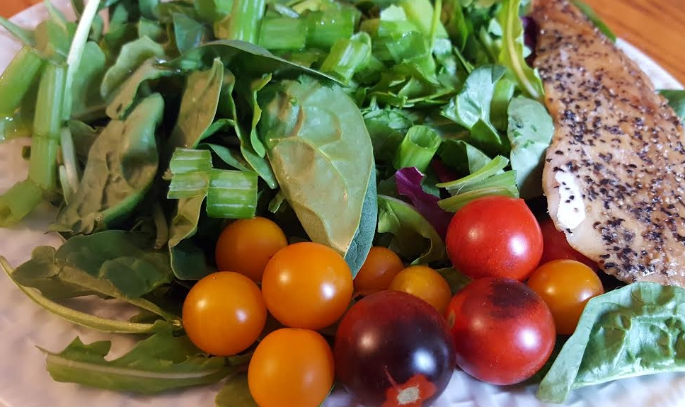Dark leafy greens with homemade lemon vinaigrette dressing, heirloom cherry tomatoes, and smoked trout.