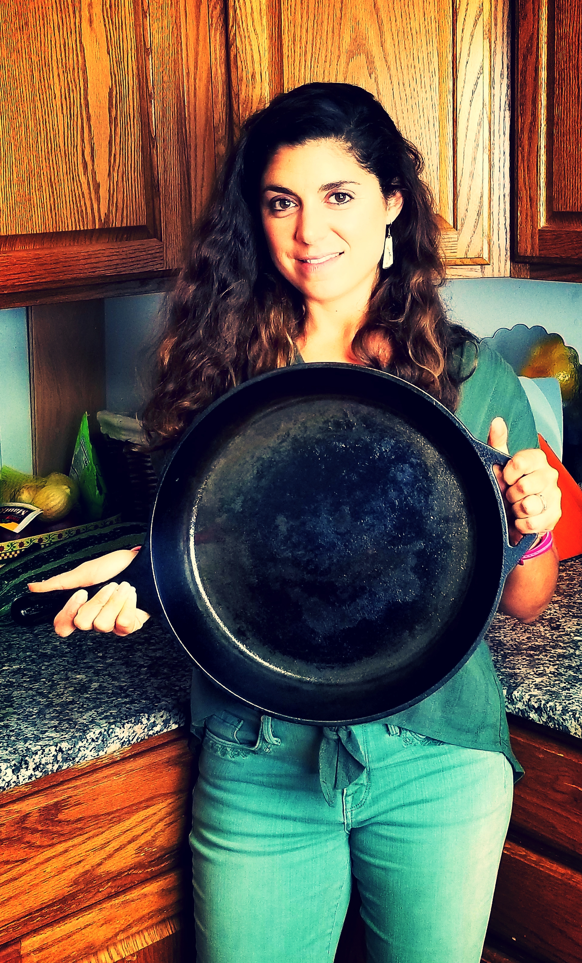 I love to cook with cast iron! I have skillets in 4 sizes (the one I'm holding here is the 14-inch skillet).