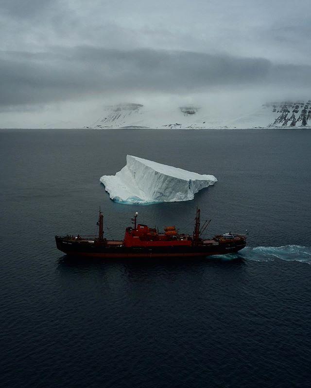 One more from the last expedition. Our icebreaker and huge iceberg.  В этой Экспедиции было много всего, но самое главное это люди. Я уверен мы ещё не раз увидимся с ребятами из научной группы и съёмочной команды. Был рад поработать вместе с @maxim_arbugaev и @leonidkruglov и всей нашей огромной, но сплочённой командой! #arctic #russian #icebreaker #expedition