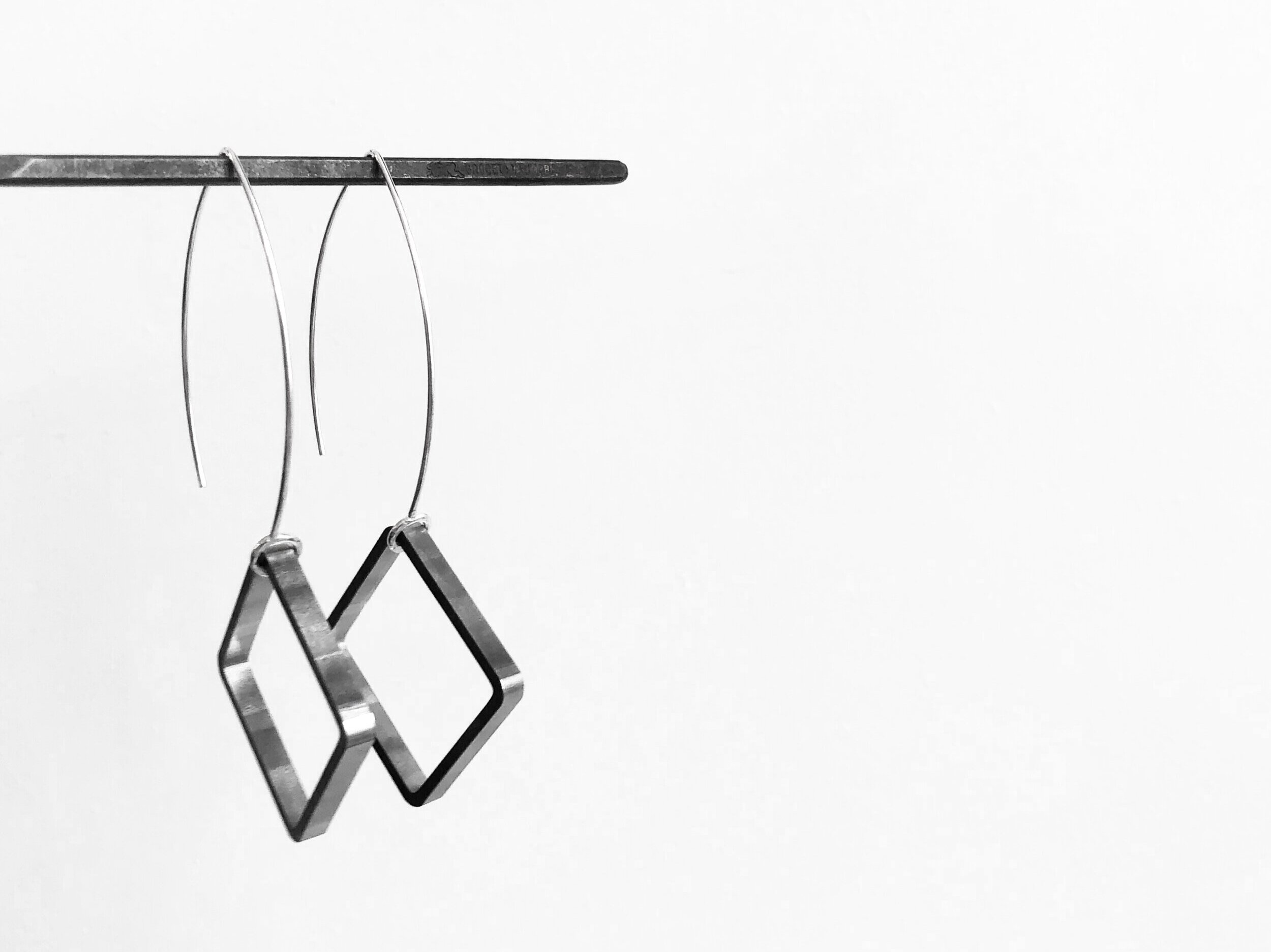 the jewelry - sable is a line of contemporary jewelry inspired by the minimal lifestyle. Each piece we make has a bold and intentional design- embracing the collision of power, strength, and elegance.we are a brand built on bridging the gap between masculine + feminine- our collections are built on simple forms and contemporary design.