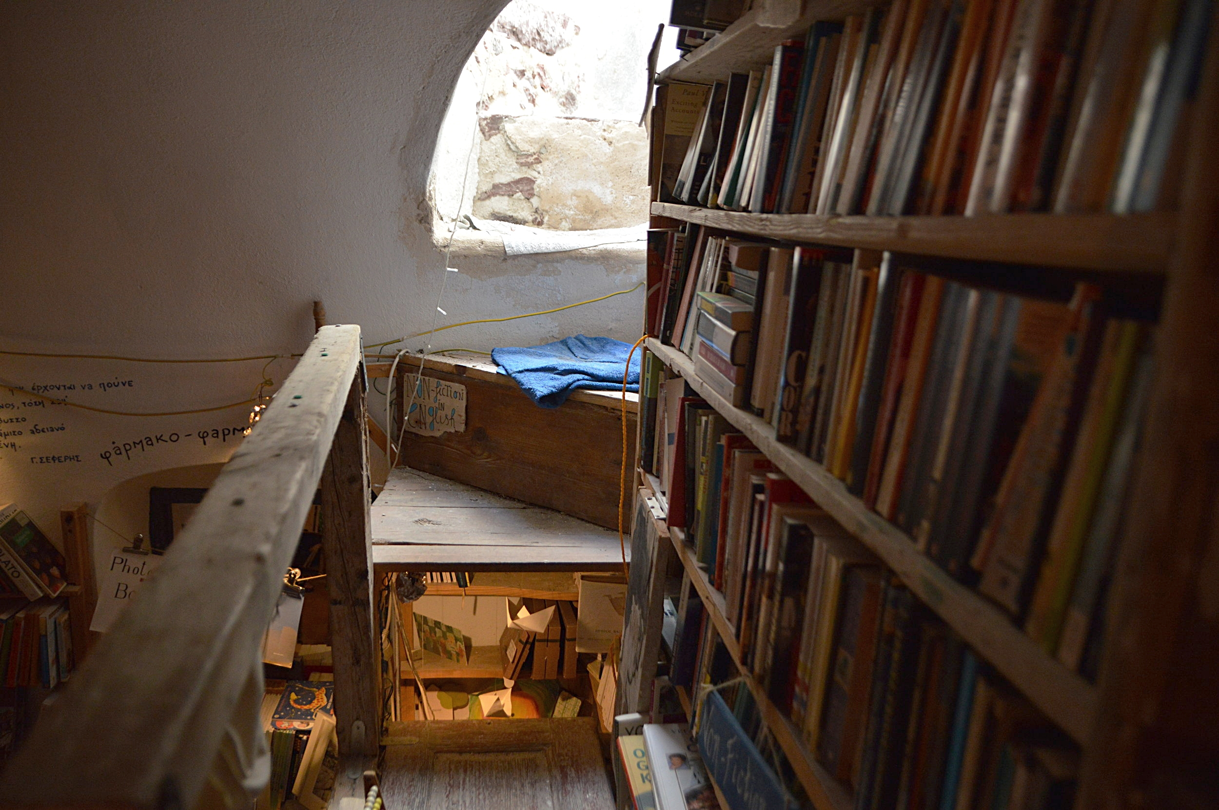 In this Santorini Bookshop, you can literally climb in and out through the roof.