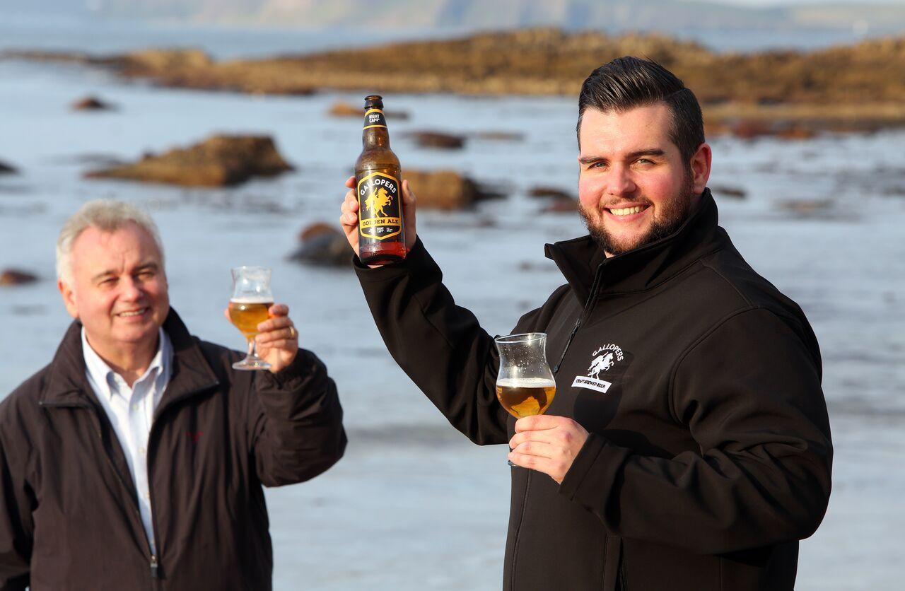 Declan and Eamon cheers on beach.jpg